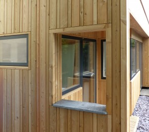 Siberian larch cladding used vertically in random widths.